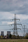 400 kV overhead electricity power lines suspended by pylons are used to transmit electric energy across large distances from Didcot Power staion across Oxfordshire, United Kingdom.