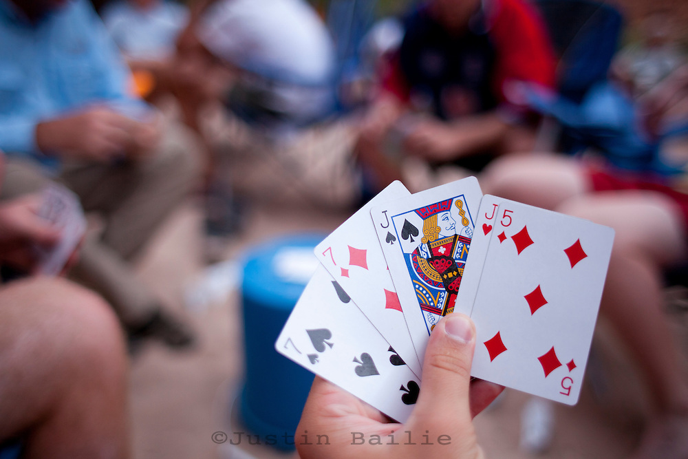 Playing cards while rafting the Grand Canyon. Grand Canyon National Park, AZ.