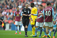 Referee Michael Oliver attempts to calm the situation. The FA Cup, semi final match, Aston Villa v Liverpool at Wembley Stadium in London on Sunday 19th April 2015.<br /> pic by John Patrick Fletcher, Andrew Orchard sports photography.