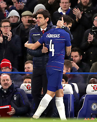 Chelsea's Cesc Fabregas (right) embraces Nottingham Forest manager Aitor Karanka as he is substituted during the Emirates FA Cup, third round match at Stamford Bridge, London.