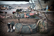 A legionnaire sleeping on his Famas (machine gun) and in combat outfit, with his bags ready, so that he can be ready in 15mn (that includes shaving time!). He must be ready to combat in the desert for at least 24 hrs...North of Djibouti town, in the desert, the French Foreign Legion (the 13th Foreign Legion Demi-Brigade) spent a week in a Forward Operating Base that they built, as part of an excercice on guerilla war, in an environment very similar to the one encountered, for example, in Afghanistan...The geostrategical and geopolitical importance of the Republic of Djibouti, located on the Horn of Africa, by the Red Sea and the Gulf of Aden, and bordered by Eritrea, Ethiopia and Somalia.