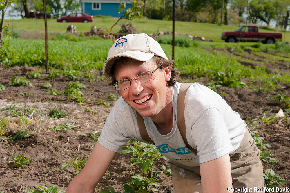 How do you smile while picking weeds by hand? For some, it's easy.