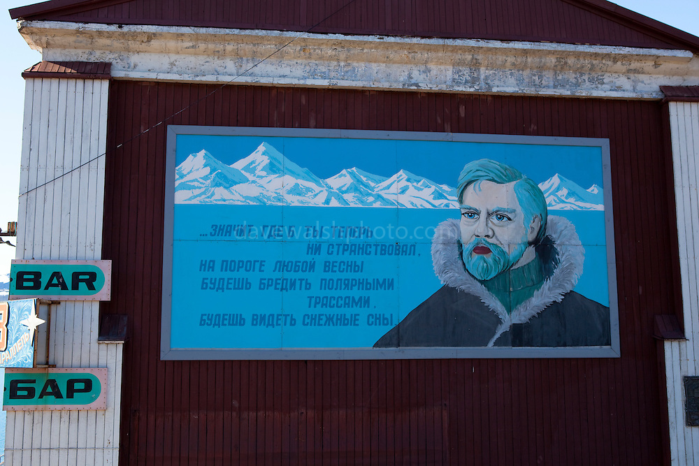 """Russian mural in Barentsburg, a Russian coal mining town in the Norwegian Archipelego of Svalbard. Once home to about 2000 miners and their families, less than 500 people now live here. This mage can be licensed via Millennium Images. Contact me for more details, or email mail@milim.com For prints, contact me, or click """"add to cart"""" to some standard print options."""