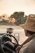 Safari guide sat in Landover, Luangwa River Valley. Zambia, Africa