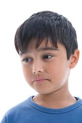 Portrait of a little boy looking sad in the studio,