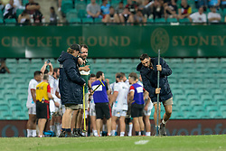March 23, 2019 - Sydney, NSW, U.S. - SYDNEY, NSW - MARCH 23: Ground staff attempt to repair the playing surface during a break in play at round 6 of Super Rugby between NSW Waratahs and Crusaders on March 23, 2019 at The Sydney Cricket Ground, NSW. (Photo by Speed Media/Icon Sportswire) (Credit Image: © Speed Media/Icon SMI via ZUMA Press)