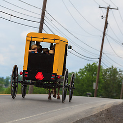 "Bellville, PA, USA - May 23, 2012: A ""yellow-topper"" Amish buggy used by a member of the Byler Amish in Kishacoquillas Valley."