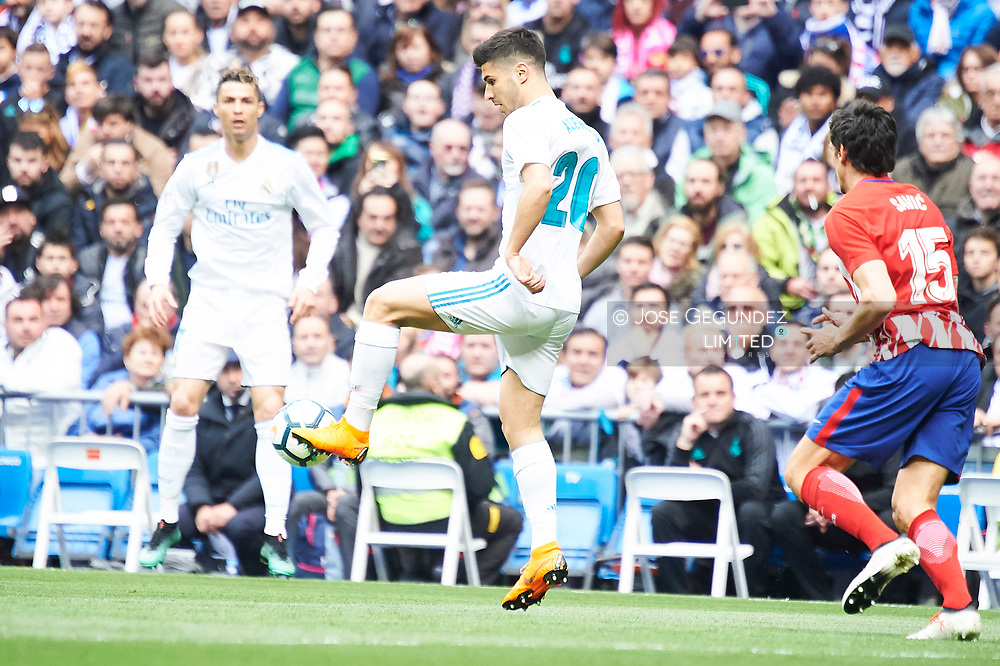 Marco Asensio (midfielder; Real Madrid) in action during La Liga match between Real Madrid and Atletico de Madrid at Santiago Bernabeu on April 8, 2018 in Madrid, Spain