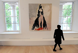 """© under license to London News Pictures. LONDON, UK  05/05/2011. A gallery worker walks in front of the tapestry 'The Black Cat' by Tracy Emin which took seven years to complete.  The unveiling today (5 May 2011) of Tracey Emin's first tapestry ahead of the launch of COLLECT, the Crafts Council's international craft fair for contemporary objects at the Saatchi Gallery, London. Tracy Emin say's: """"The Black Cat is one of my favourite paintings. It took me seven years to complete...""""Photo credit should read Stephen Simpson/LNP."""