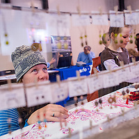 111513       Cable Hoover<br /> <br /> Jenny Van Drunen and her daughter Maggi Van Drunen look at the selection of jewelry and crafts at the Makeshift Gallery booth during the Recycled Arts & Crafts Show at the Gallup Community Service Center Saturday.