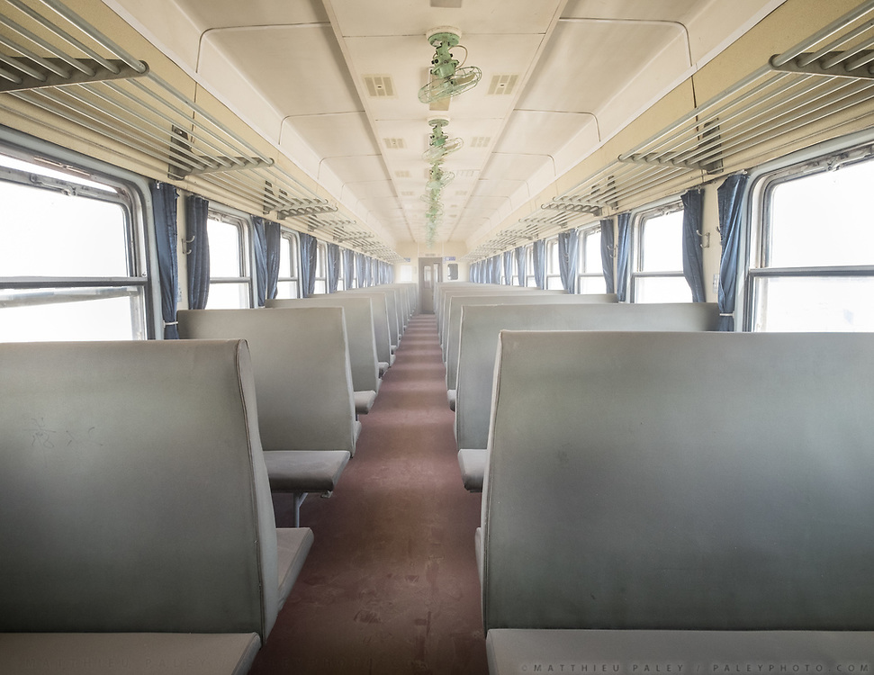 A wagon is full of dust and sand from the desert because of a broken window. Life inside the train - mostly Muslim Uighur people  ride this train.