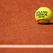 PARIS, FRANCE May 23.  A 2019 Roland Garros tennis ball on the clay surface of Court Philippe-Chatrier at the 2019 French Open Tennis Tournament at Roland Garros on May 23rd 2019 in Paris, France. (Photo by Tim Clayton/Corbis via Getty Images)