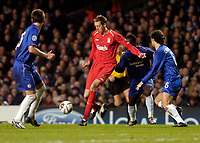 Photo: Leigh Quinnell.<br /> Chelsea v Liverpool. UEFA Champions League. <br /> 06/12/2005. Liverpools Peter Crouch can't find a way past a sea of Chelsea players.