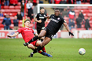 Barnsley defender Dimitri Cavare (12) is fouled by Walsall FC midfielder George Dobson (4)  during the EFL Sky Bet League 1 match between Walsall and Barnsley at the Banks's Stadium, Walsall, England on 23 March 2019.