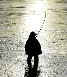 Anglers from all over the country arrived in Kinclaven, Perthshire for the first day of the new salmon fishing season on the River Tay, which is marked with whisky and sees the anglers led to the water by pipers.<br /> <br /> © Dave Johnston / EEm
