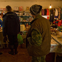 North of the Arctic Circle in Russia, people shop in a store in Snopa village, which is primarily occupied by ethnic Russians, but where the nomadic Komi reindeer herders periodically procures fresh food, staples and vodka.