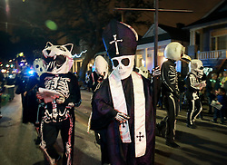 28 Feb 2014. New Orleans, Louisiana.<br /> Mardi Gras. Dada Bob with the Skeleton Krewe as they prepare to walk the route for The Krewe D'Etat parade along Magazine Street through Uptown New orleans. <br /> Photo; Charlie Varley/varleypix.com