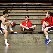 On Thursday November 3, before the Santa Ana College Dons vs. Palomar College Comets, Karell Santos (left), Hannah Marquez (center), and Natalie Benavides (right), socialize and get ready for the start of the game in Santa Ana, CA. The final score the of game was 76 Comets, 61 Dons. Photograph taken by ©Mikailin Rae Perry, Sports Shooter Academy
