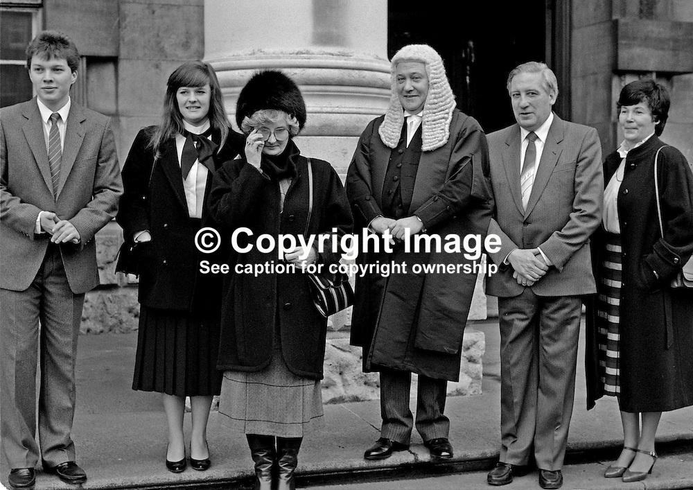 James Brady, QC, barrister, N Ireland, UK, pictured at Belfast High Court on the occasion he took silk. He is with family and friends. 19850005JB2.<br /> <br /> Copyright Image from Victor Patterson, Belfast, UK<br /> <br /> t: +44 28 9066 1296 (from Rep of Ireland 048 9066 1296)<br /> m: +44 7802 353836<br /> e: victorpattersonbelfast@gmail.com<br /> <br /> www.images4media.com<br /> <br /> Please see my full Terms and Conditions of Use at https://www.images4media.com/p/terms-conditions - it is IMPORTANT that you familiarise yourself with them.<br /> <br /> Images used online incur an additional cost. This cost should be agreed in writing in advance. Online images must be visibly watermarked i.e. © Victor Patterson or that of the named photographer within the body of the image. The original metadata must not be deleted from images used online.<br /> <br /> This image is only available for the use of the download recipient i.e. television station, newspaper, magazine, book publisher, etc, and must not be passed on to a third party. It is also downloaded on condition that each and every usage is notified within 7 days to victorpattersonbelfast@gmail.com.<br /> <br /> The right of Victor Patterson (or the named photographer) to be identified as the author is asserted in accordance with The Copyright Designs And Patents Act (1988). All moral rights are asserted.