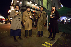 © Licensed to London News Pictures.15/12/2020. London, UK. Londoners making the most of the last night out in Soho, before London will go into Tier 3 tomorrow. Photo credit: Marcin Nowak/LNP