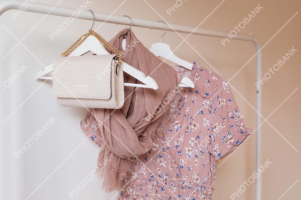 Fashionable handbag hanging on a clothesline.