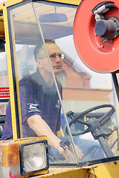 Man with disability driving forklift truck,
