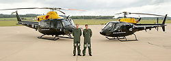File photo dated 18/6/2009 of Prince William and Harry during a photocall at their military helicopter training course base at RAF Shawbury, Shrewsbury.