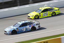 August 12, 2018 - Brooklyn, Michigan, United States of America - Kevin Harvick (4) and Ryan Blaney (12) battle for position during the Consumers Energy 400 at Michigan International Speedway in Brooklyn, Michigan. (Credit Image: © Chris Owens Asp Inc/ASP via ZUMA Wire)