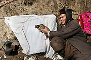 Mamalai holding the only remaining chicken in the Pamir, which lost a leg die to frost bite..One of the only two chickens surviving up in the Little Pamir..The Kyrgyz settlement of Ech Keli, above Chaqmaqtin lake, Er Ali Boi's camp...Trekking through the high altitude plateau of the Little Pamir mountains, where the Afghan Kyrgyz community live all year, on the borders of China, Tajikistan and Pakistan.