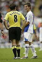 Photo: Aidan Ellis.<br /> Blackburn Rovers v Manchester City. The Barclays Premiership. 17/09/2006.<br /> Rovers Morten Gamst Pedersen shares a joke with City's  Joey Barton