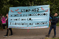 Stop HS2 activists arrive to take part in an Extinction Rebellion Stop The Harm march during the fourth day of Impossible Rebellion protests on 26th August 2021 in London, United Kingdom. Extinction Rebellion are calling on the UK government to cease all new fossil fuel investment with immediate effect and Stop HS2 are calling for the HS2 high-speed rail project to be cancelled.