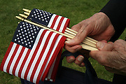 Free American flags were passed out before the 85th Annual Memorial Day services at Veterans Memorial Cemetery at Evergreen Washelli. (Greg Gilbert / The Seattle Times)
