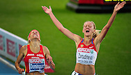 Russia's Yuliya Zarudneva (R) reacts after wining the women's 3000m steeplechase final ahead of Spain's Marta Dominguez at the 2010 European Athletics Championships at the Olympic Stadium in Barcelona on July 30, 2010
