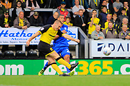 Burton Albion defender Jake Buxton (23) clears from Cardiff City defender Lee Peltier (2) during the EFL Sky Bet Championship match between Burton Albion and Cardiff City at the Pirelli Stadium, Burton upon Trent, England on 5 August 2017. Photo by Richard Holmes.