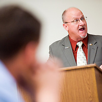 030713       Cable Hoover<br /> <br /> Bill Noe moderates a debate for city council Thursday at the Gallup Chamber of Commerce Thursday.