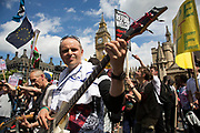 Happy dancing singing demonstrators at the Peoples Assembly demonstration arrives in Parliament Square: No More Austerity - No To Racism - Tories Must Go, on Saturday July 16th in London, United Kingdom. Tens of thousands of people gathered to protest in a march through the capital protesting against the Conservative Party cuts. Almost 150 Councillors from across the country have signed a letter criticising the Government for funding cuts and and will be joining those marching in London. The letter followed the recent budget in which the Government laid out plans to cut support for disabled people while offering tax breaks for big business and the wealthy.