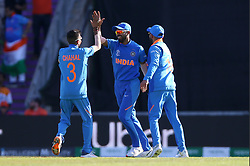 India's Mohammed Shami (centre) celebrates taking the wicket of Afghanistan's Aftab Alam during the ICC Cricket World Cup group stage match at the Hampshire Bowl, Southampton.