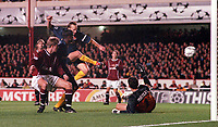 Lee Dixon shoots past Sparta Prague goalkeeper Tomas Postulka to score the 3rd Arsenal goal after Thierry Henrys free-kick is saved. Arsenal 4:2 Sparta Prague, UEFA Champions League, Group B, 25/10/2000. Credit Colorsport / Andrew Cowie.