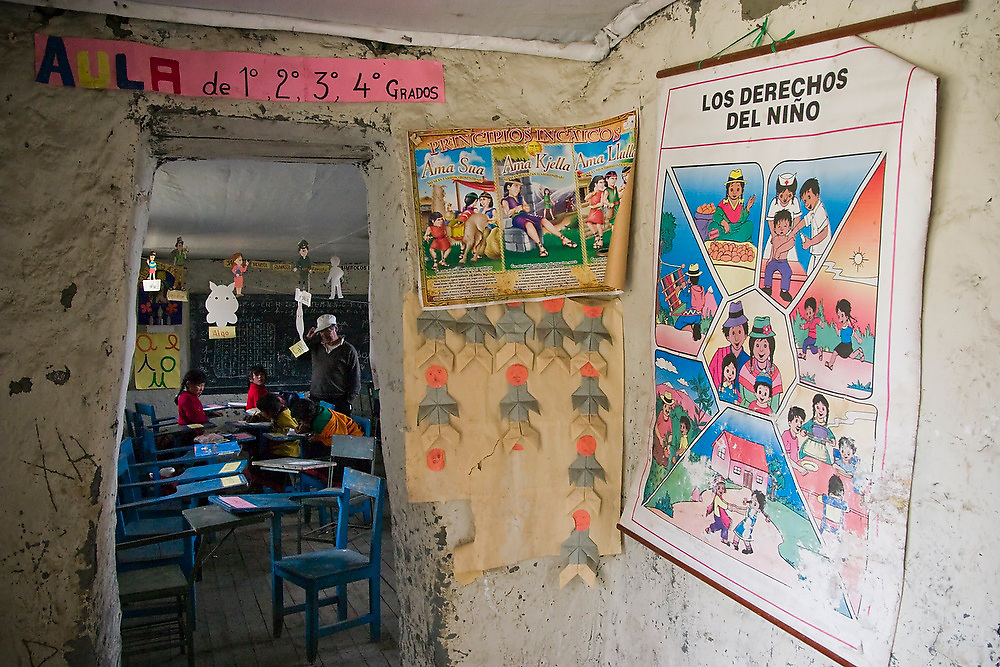 A poster in Spanish describing the rights of the child hangs inside the small elementary school in Q'eros, Cordillera de Paucartambo, Andes Mountains, Peru. The students are taught in both their native Quechua and Spanish, the official language of Peru.