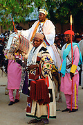 Honoured chief riding a decorated horse with attendants at a traditional Durbar gathering in Maidugari, Nigeria, West Africa