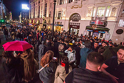 Licensed to London News Pictures. 10/10/2020. London, UK. Revellers dancing with blaring sound system at Piccadilly Circus, central London. After the 10pm curfew early closing of pubs and bars. Photo credit: Marcin Nowak/LNP
