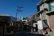 Two women walk down the road in Kargil