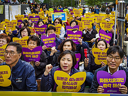 October 10, 2018 - Seoul, Gyeonggi, South Korea - Koreans at the Wednesday Demonstration to protest Japan's sexual enslavement of Korean women during World War II. The Wednesday protests have been taking place since January 1992. Protesters want the Japanese government to apologize for the forced sexual enslavement of up to 400,000 Asian women during World War II. The women, euphemistically called ''Comfort Women'' were drawn from territories Japan conquered during the war and many came from Korea, which was a Japanese colony in the years before and during the war.  (Credit Image: © Jack Kurtz/ZUMA Wire)