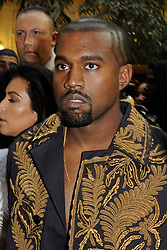 "File photo of Kayne West attending Balmain's Spring-Summer 2015 Ready-To-Wear collection show held at the Palais de Tokyo in Paris, France, on September 25, 2014. Kim Kardashian West spoke out about Kanye West's bipolar disorder Wednesday, three days after the rapper delivered a lengthy monologue at a campaign event touching on topics from abortion to Harriet Tubman, and after he said he has been trying to divorce her.Kardashian West said in a statement posted in an Instagram Story that she has never spoken publicly about how West's bipolar disorder has affected their family because she is very protective of their children and her husband's ""right to privacy when it comes to his health."" Photo by Alban Wyters/ABACAPRESS.COM"
