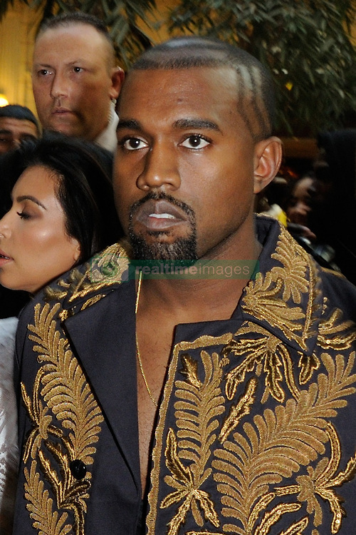 """File photo of Kayne West attending Balmain's Spring-Summer 2015 Ready-To-Wear collection show held at the Palais de Tokyo in Paris, France, on September 25, 2014. Kim Kardashian West spoke out about Kanye West's bipolar disorder Wednesday, three days after the rapper delivered a lengthy monologue at a campaign event touching on topics from abortion to Harriet Tubman, and after he said he has been trying to divorce her.Kardashian West said in a statement posted in an Instagram Story that she has never spoken publicly about how West's bipolar disorder has affected their family because she is very protective of their children and her husband's """"right to privacy when it comes to his health."""" Photo by Alban Wyters/ABACAPRESS.COM"""