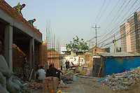 China, Beijing, Chaoyang, San Jian Fang, 2008. Construction teams moved onto Chaoyang Street in short order, often working side-by-side with demolition crews and sharing the same temporary shelters.