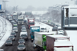 © under license to London News Pictures.  18/12/2010. Traffic battles through heavy snow along the M4 near junction 4 for the M25 today (18/12/2010).  Severe weather is expected to hit the whole of the UK this weekend. Photo credit should read Sam Long/ London News Pictures