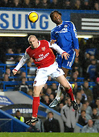 Photo: Ed Godden.<br /> Chelsea v Arsenal. The Barclays Premiership. 10/12/2006.<br /> Arsenal's Philippe Senderos (L),competes for the ball with Didier Drogba.