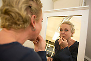 Kristin Hersh putting on her make up backstage. Throwing Muses at the Islington Assembly Hall, London, UK. Throwing Muses are an alternative rock band founded in 1980. The group was originally fronted by two lead singers, Kristin Hersh, and Tanya Donelly. Known for performing music with shifting tempos, creative chord progressions, unorthodox song structures, and surreal lyrics, the group was set apart from other contemporary acts by Hersh's stark, writing style, David Narcizo's unusual drumming techniques almost totally without cymbals and Bernard Georges' driving baselines.