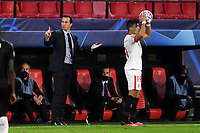 SEVILLE, SPAIN - OCTOBER 28: Marcos Acuna of FC Sevilla and Julien Stepha, coach of Stade Rennais during the UEFA Champions League Group E stage match between FC Sevilla and Stade Rennais at Estadio Ramon Sanchez-Pizjuan on October 28, 2020 in Seville, Spain. (Photo by Juan Jose Ubeda/ MB Media).